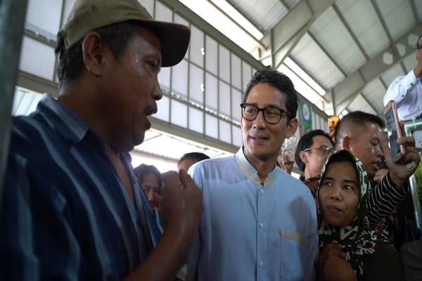 Sandi berdialog dengan pedagang Pasar Angso Duo Jambi, Jumat (25/01/2019) - ist
