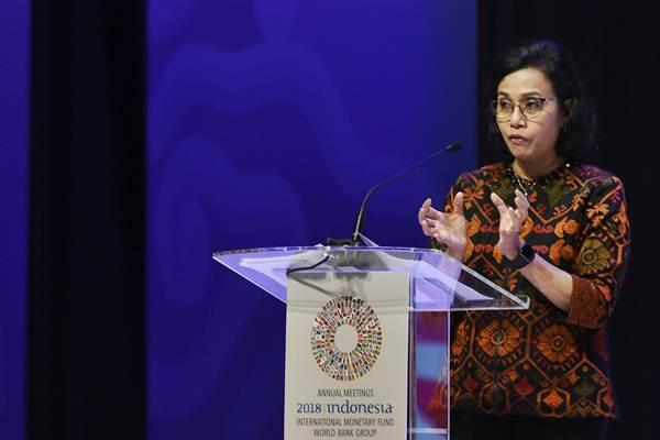 Menteri Keuangan Sri Mulyani menyampaikan paparan pada High Level Dialogue Disaster Risk Financing and Insurance in Indonesia dalam rangkaian Pertemuan Tahunan IMF World Bank Group 2018 di BICC Nusa Dua, Bali, Rabu (10/10/2018). - ANTARA/Puspa Perwitasari