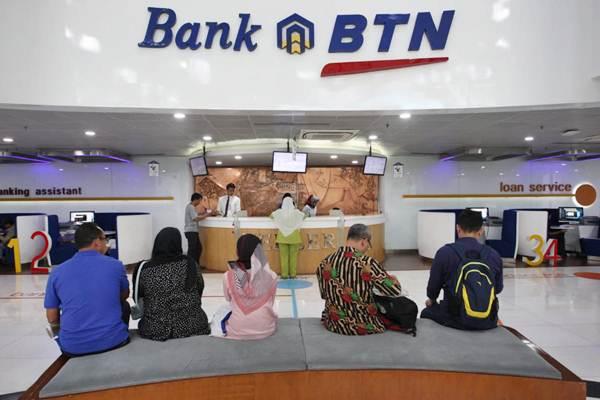 Aktivitas layanan nasabah di kantor PT Bank Tabungan Negara Tbk (BTN), di Jakarta, Rabu (2/1/2018). - Bisnis/Dedi Gunawan