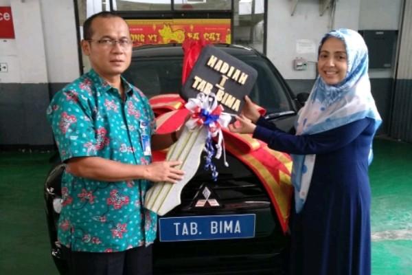 Fatmah Muna Alimeraih hadiah pertama berupa satu unit mobil Mitsubisi Expander terbaru Tabungan Bima Bank Jateng periode 2 Tahun 2018.