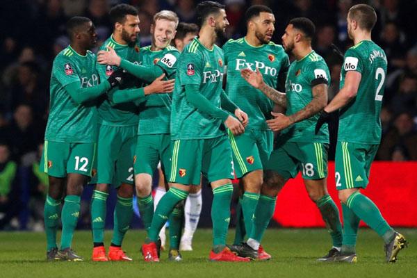 Para pemain Watford bersukacita selepas menjebol gawang Queens Park Rangers. - Reuters/David Klein