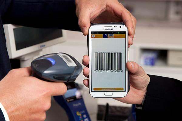 lustrasi pembayaran menggunakan barcode di ponsel pintar. Fintech dinilai lebih unggul dibandingkan dengan perbankan, e/commerce, dan perusahaan telekomunikasi dalam hal pengembangan layanan uang elektronik. / Wikimedia Common