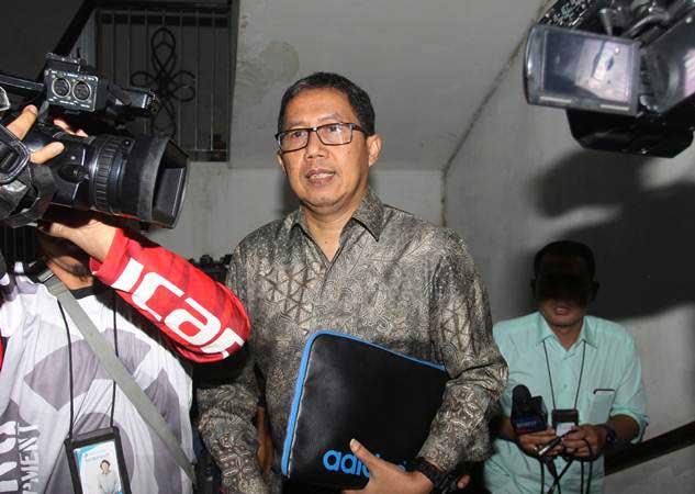 Plt Ketua Umum PSSI Joko Driyono tiba di gedung Krimum sebelum menjalani pemeriksaan, Polda Metro Jaya, Jakarta, Kamis (21/2/2019). - ANTARA/Reno Esnir