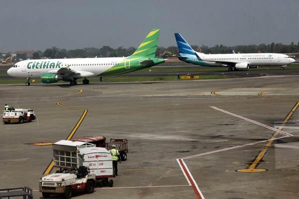 Aktivitas penerbangan di Terminal 2 Bandara Soekarno Hatta, Tangerang, Banten, Selasa (18/12/2018). - ANTARA/Yulius Satria Wijaya