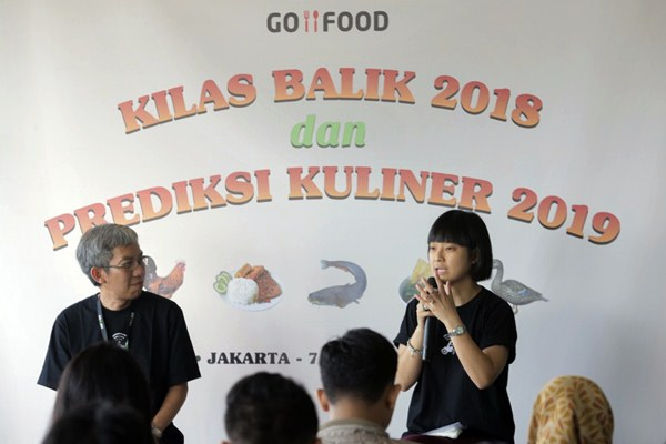 Chief Commercial Expansion Gojek Catherine Hindra Sutjahyo (kanan) dan VP Marketing Gofood Aristo Kristandyo memberikan paparan dalam acara Kilas Balik 2018 dan Prediksi Kuliner 2019 di Jakarta, Senin (7/1/2019). - Bisnis/Felix Jody Kinarwan