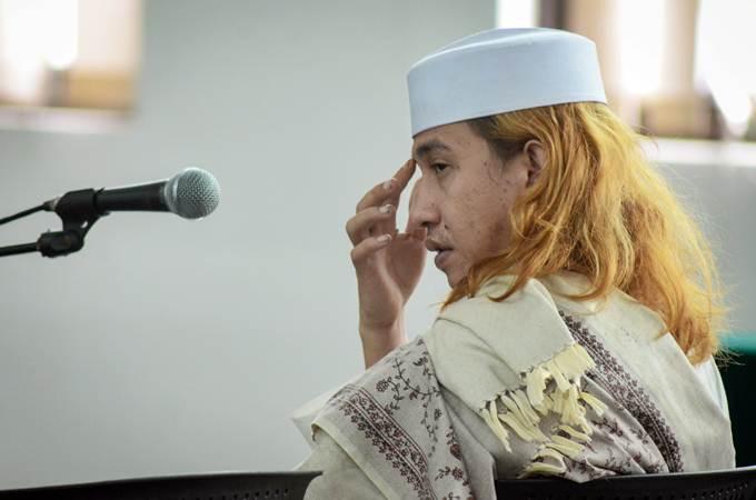 Terdakwa kasus dugaan penganiayaan terhadap remaja Bahar bin Smith menjalani sidang lanjutan di Gedung Perpustakaan dan Kearsipan Kota Bandung, Jawa Barat, Kamis (14/3/2019). - ANTARA/Raisan Al Farisi