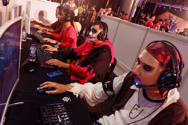 Peserta bermain game online PUBG pada acara Spirit of Millennials Games Day 2018 di JI Expo Kemayoran, Jakarta, Kamis (13/12/2018). - JIBI/Nurul Hidayat