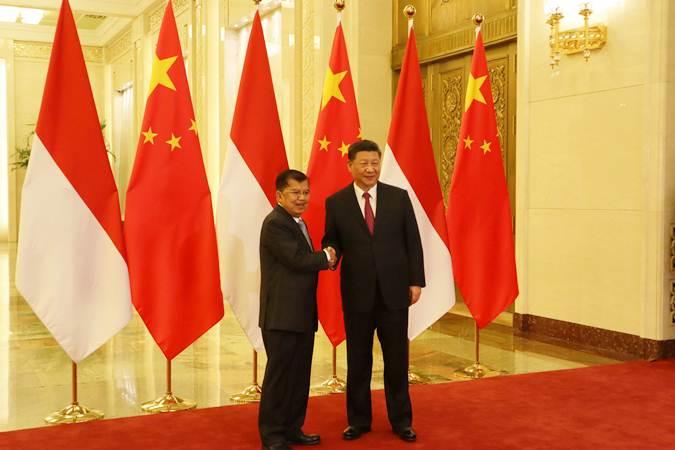 Wakil Presiden Jusuf Kalla (kiri) bertemu Presiden China Xi Jinping di Balai Agung Rakyat, Beijing, Kamis (25/4/2019). - ANTARA/M, Irfan Ilmie