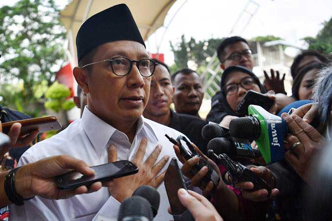 Menteri Agama Lukman Hakim Saifuddin tiba untuk menjalani pemeriksaan di kantor KPK, Jakarta, Rabu (8/5/2019). - ANTARA/Sigid Kurniawan