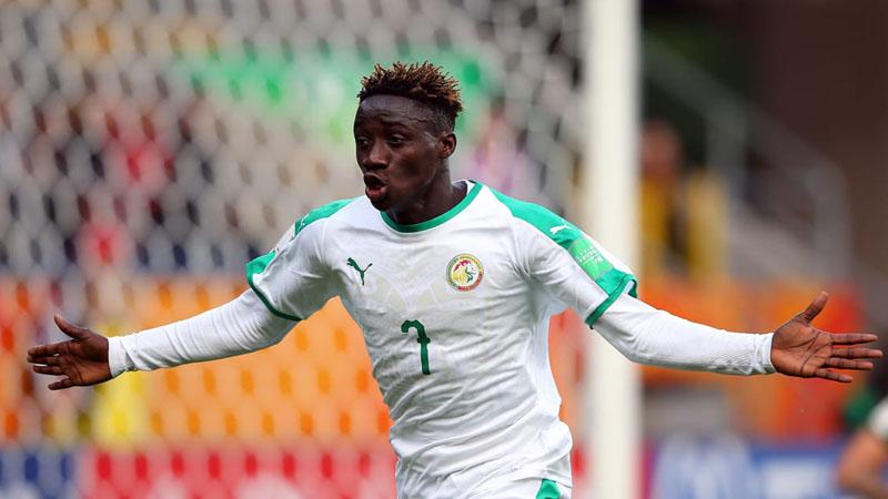 Penyerang Timnas Senegal U-20 Amadou Sagna setelah menjebol gawang Tahiti U-20, yang menjadi rekor gol tercepat sepanjang sejarah Piala Dunia U-20 sejak digelar pertama pada 1977. Sagna mencetak gol ketika pertandingan baru berjalan 9,6 detik. - FIFA.com