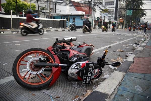 Suasana pasca kerusuhan di sekitaran jalan MH. Thamrin, Jakarta, Kamis (23/5/2019). - ANTARA FOTO/Yulius Satria Wijaya
