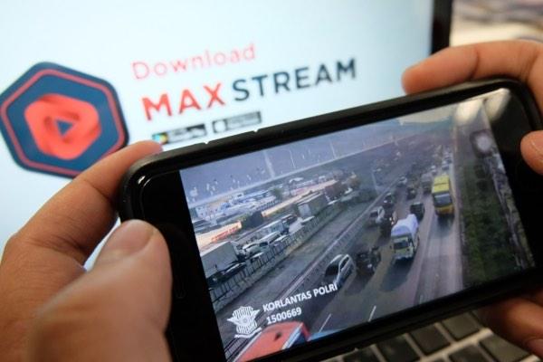 Aplikasi MAXstream bisa membantu para pemudik memantau kondisi jalan menuju kampung halaman. - Bisnis/Tim Jelajah Jawa/Bali