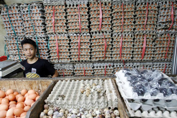 Ilustrasi pedagang bahan panbgan di pasar tradisonal. - Reuters/Iqbal Rinaldi