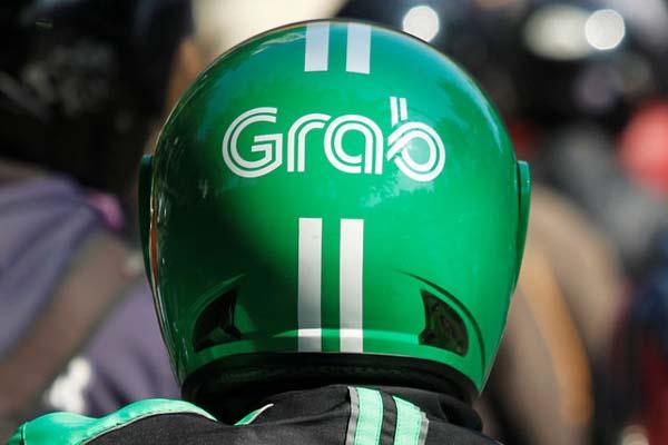 Ilustrasi - Pengemudi Grab Bike - Reuters/Iqro Rinaldi