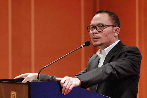 Menteri Ketenagakerjaan M. Hanif Dhakiri menyampaikan sambutan pada simposium Kadin Indonesia mengenai pendidikan vokasi, di Jakarta, Selasa (31/10). - JIBI/Dwi Prasetya
