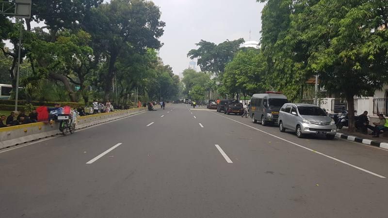 Suasana satu ruas Jalan Medan Merdeka Barat yang ditutup oleh aparat, Rabu (26/6/2019. - JIBI/Bisnis/Lalu Rahadian