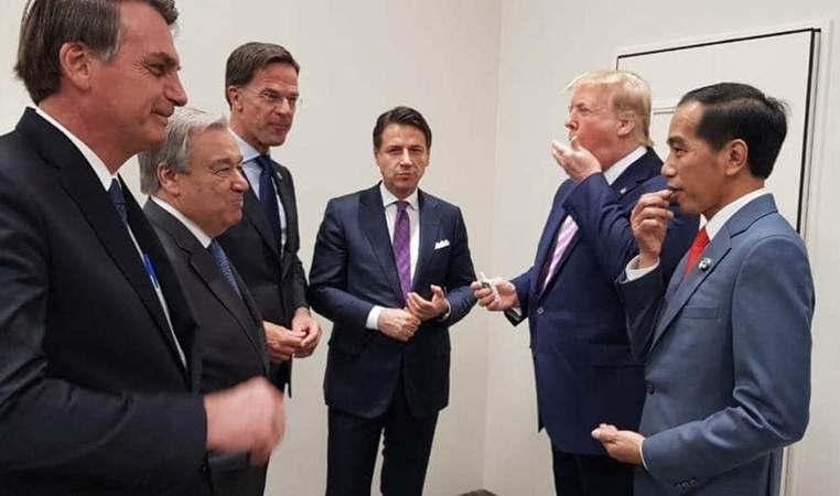Presiden Joko Widodo (kanan) bersama Presiden Amerika Serikat Donald Trump (kedua kanan) menjelang sesi foto di sela-sela menghadiri KTT G20, di Osaka, Jepang, Jumat (28/6/2019). Konferensi Tingkat Tinggi (KTT) G20 digelar pada tanggal 28-29 Juni 2019. - Setkab