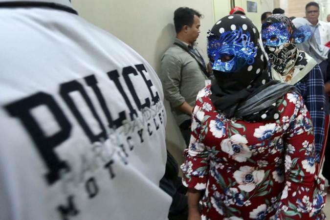 Korban perdagangan orang dihadirkan saat rilis pengungkapan tindak pidana perdagangan orang di Jakarta, Selasa (9/4/2019). - Bisnis/Nurul Hidayat