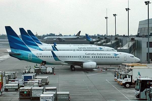 Pesawat Garuda Indonesia berada di terminal 3 Bandara Soekarno-Hatta, Tangerang, Banten. - Bisnis/Paulus Tandi Bone