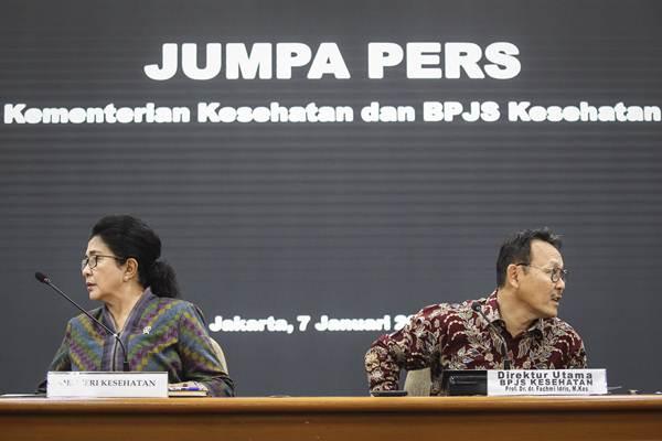 Menteri Kesehatan Nila Moeloek (kiri) bersama Dirut BPJS Kesehatan Fachmi Idris bersiap menyampaikan keterangan pers, di Jakarta, Senin (7/1/2019). - ANTARA/Dhemas Reviyanto
