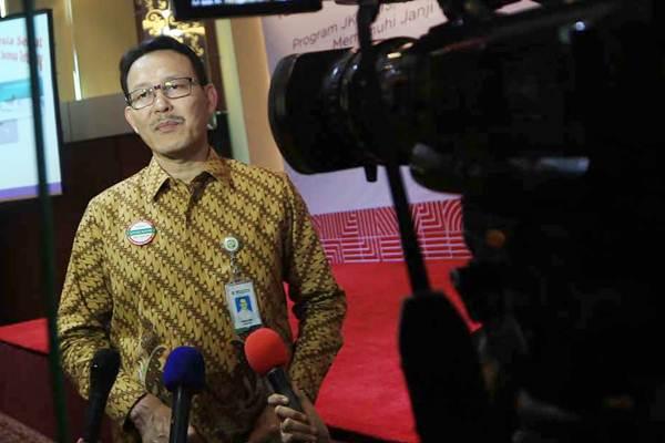 Dirut BPJS Kesehatan Fahmi Idris menjawab pertanyaan wartawan di Jakarta, Selasa (15/8). - JIBI/Nurul Hidayat