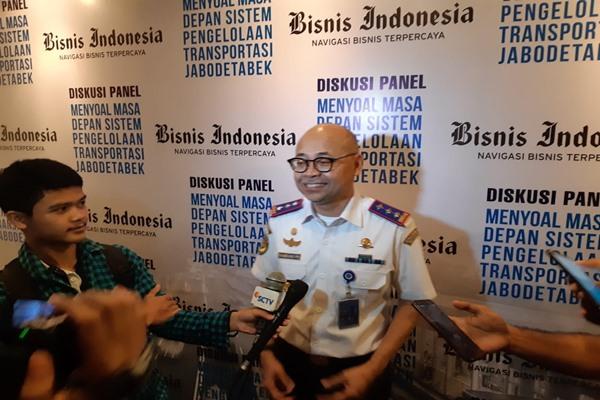 Kepala Badan Pengelola Transportasi Jabodetabek (BPTJ) Bambang Prihartono saat memberikan keterangan pers seusai diskusi panel menyoal masa depan sistem pengelolaan transportasi Jabodetabek, Kamis (2/5/2019). Dia mengungkapkan perlunya peran swasta dalam menjalankan rencana aksi 2020-2024, total investasi swasta yang dibutuhkan mencapai Rp247,5 triliun atau sebesar 75,12% dari total investasi Rp329,5 triliun. - Bisnis/Rinaldi M. Azka