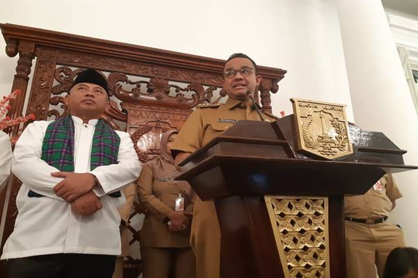 Wali Kota Bekasi Rahmat Effendi dan Gubernur DKI Jakarta Anies Baswedan/JIBI - BISNIS/Feni Freycinetia Fitriani