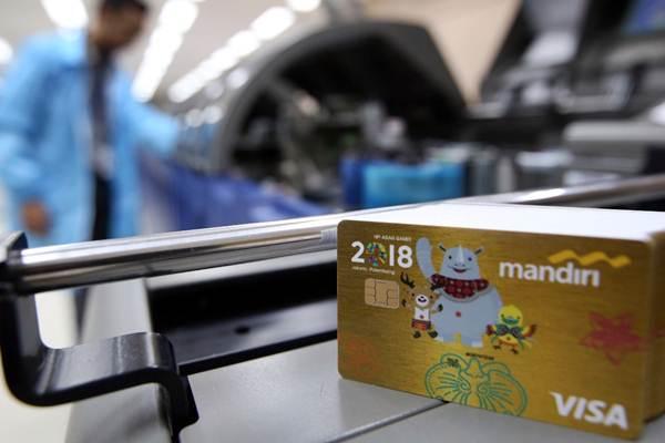 Proses pencetakan kartu kredit edisi Asian Games 2018 di Unit Pembuatan Kartu Bank Mandiri, Jakarta, Kamis (1/3/2018). - JIBI/Abdullah Azzam