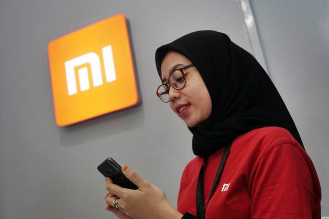 Karyawan beraktivitas di salah satu gerai Xiaomi, di Jakarta, Senin (29/7/2019). - Bisnis/Himawan L Nugraha