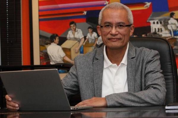 Direktur Utama PT Pos Indonesia Gilarsi W. Setijono - Bisnis