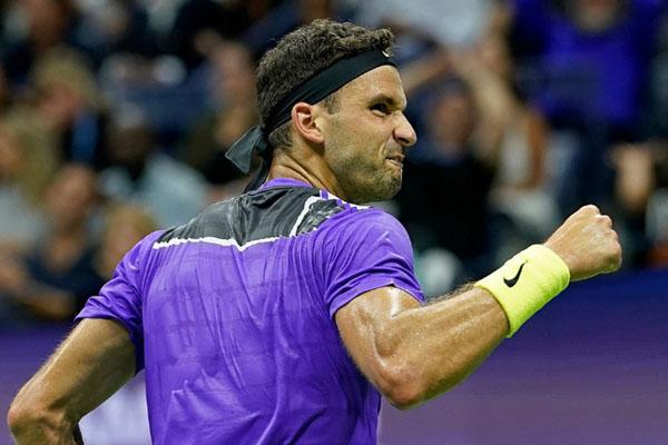 Grigor Dimitrov ketika menundukkan Roger Federer. - USOpen.org