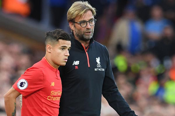 Pelatih Liverpool (kanan) Jurgen Klopp dan Philippe Coutinho - Sky Sports