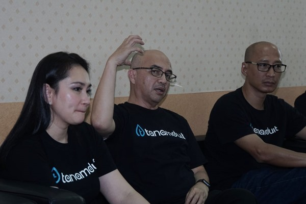 Founder & CEO Tanamduit Rini Hapsari (kiri), Direktur Tanamduit Muhammad Hanif (tengah), dan Founder & Commissioner Tanamduit Indra Suryawan saat berkunjung ke redaksi Bisnis Indonesia, Rabu (11/9/2019). BISNIS - Himawan Lisya Nugraha