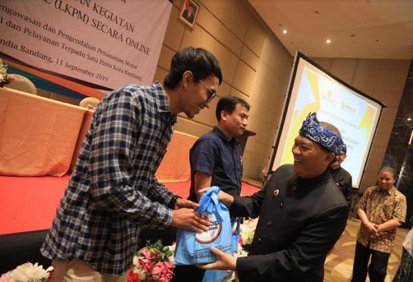 Workshop Laporan Kegiatan Penanaman Modal (LKPM) Online Kepada Pelaku Usaha di Kota Bandung di Hotel Grandia. - Bisnis/Dea Andriyawan