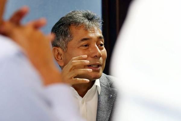 Direktur Utama PT Pegadaian (Persero) Sunarso memberikan penjelasan tentang kinerja perusahaanya saat berkunjung ke kantor redaksi Harian Bisnis Indonesia, di Jakarta, Kamis (22/3/2018). - JIBI/Abdullah Azzam