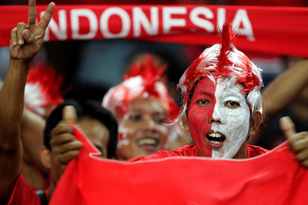 Suporter Timnas Indonesia - Reuters