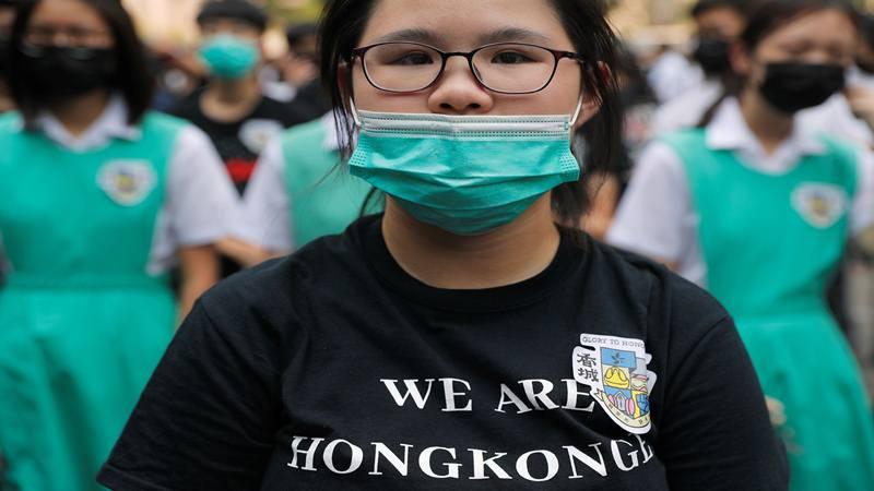 Siswa ambil bagian dalam demonstrasi menjelang Hari Nasional China, di Chater Garden di Hong Kong, China 30 September 2019. - Reuters