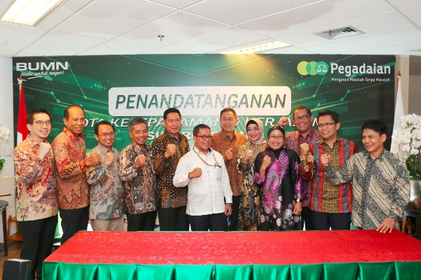 penandatanganan nota kesepahaman sinergi bisnis antara PT Pegadaian (Persero) dan 9 BUMN, Jakarta, Senin (30 - 9).
