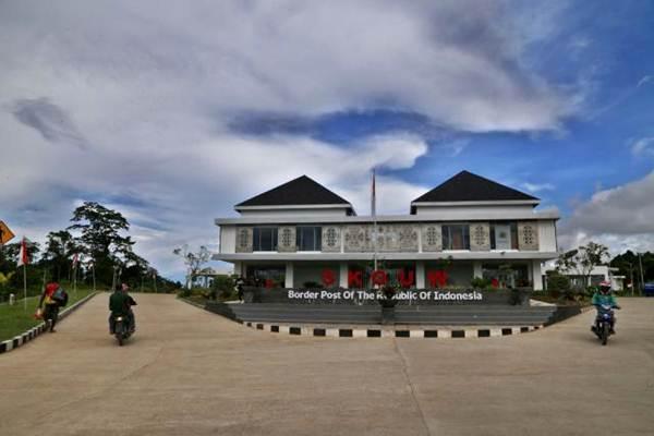 Penduduk Papua Nugini melintas di Pos Lintas Batas Negara (PLBN) Terpadu Skouw, Jayapura, Papua - JIBI/Nurul Hidayat