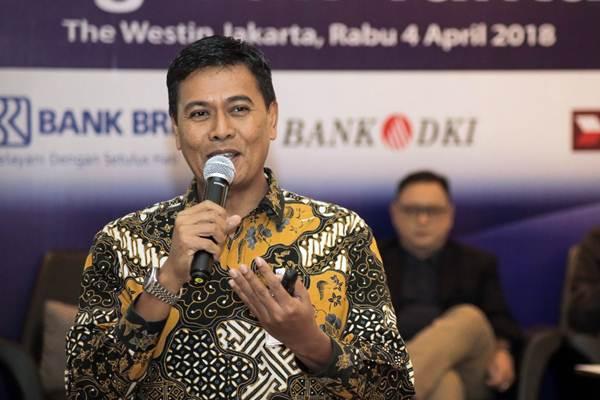 Anggoro Eko Cahyo yang juga Ketua Asosiasi Sistem Pembayaran Indonesia memberikan paparan dalam dalam seminar Tren Ekonomi Digital: Era Transaksi Elektronik, Peluang, dan Tantangan, di Jakarta, Rabu (4/4/2018). - JIBI/Felix Jody Kinarwan