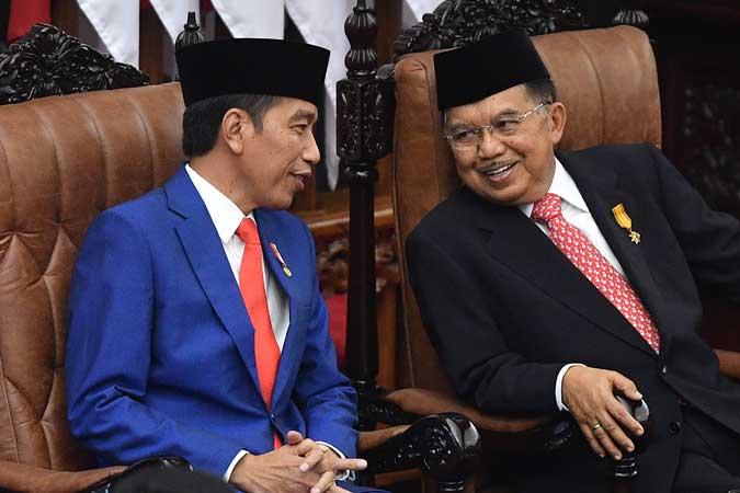Presiden Joko Widodo (kiri) dan Wakil Presiden Jusuf Kalla - ANTARA FOTO/Sigid Kurniawan