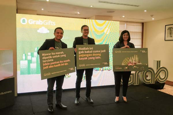 CEO Tiphone Lily Salim, Executive Director Grab Ongki Kurniawan, Head of Grab for Business Indonesia Roy Nugroho