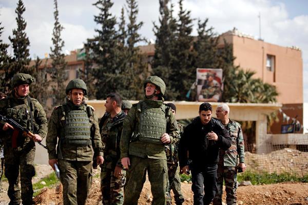 Tentara Rusia dan Suriah di Ghouta Timur, Damaskus. - Reuters