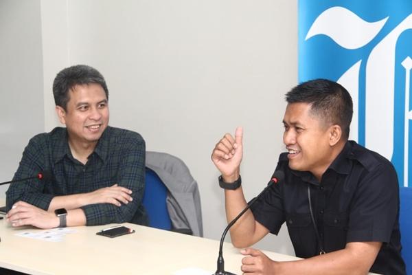 Presiden Grab Indonesia Ridzki Kramadibrata (kiri) dan Pemimpin Redaksi Bisnis Indonesia, Hery Trianto - Bisnis/Rahmad Fauzan