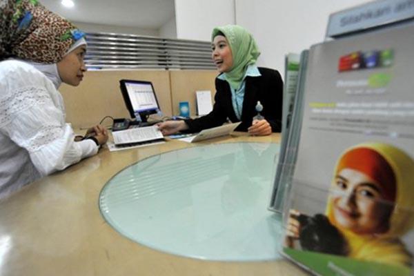 Ilustrasi kegiatan agen asuransi - Antara/Andika Wahyu