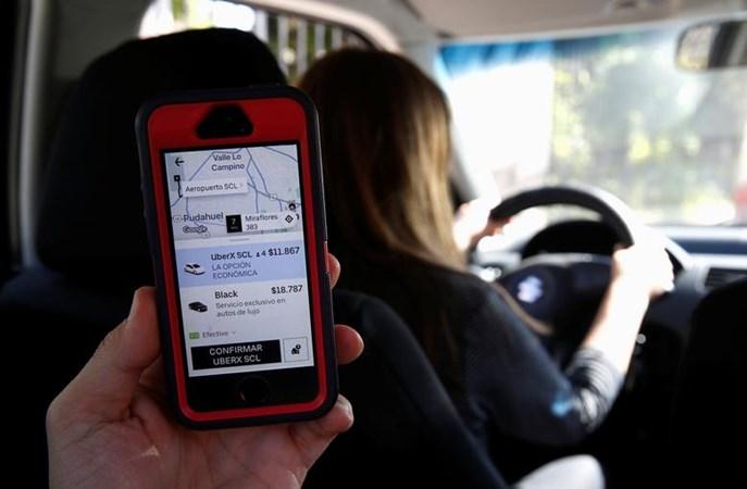 Layanan taksi Uber. - Reuters