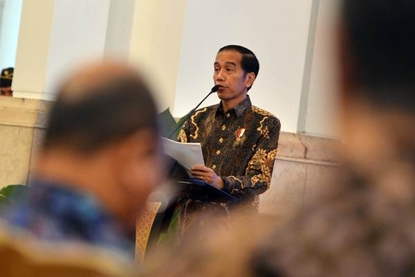 Presiden Joko Widodo menyampaikan paparan dihadapan pimpinan bank umum di Indonesia, di Istana Negara, Jakarta, Kamis (15/3/2018). - ANTARA/Wahyu Putro A