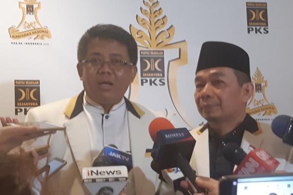Presiden Partai Keadilan Sejahtera (PKS) Sohibul Iman (kanan) bersama Ketua Fraksi DPR PKS Jazuli Juwaini. - Bisnis/Jaffry Prabu Prakoso