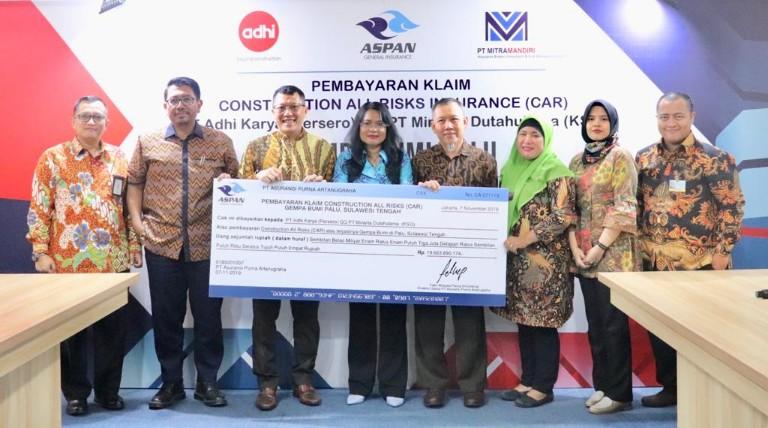 PT Asuransi Purna Artanugraha membayarkan klaim asuransi Construction All Risks Rp19 miliar kepada PT Adhi Karya (Persero) QQ PT Minarta Dutahutama (KSO). - Istimewa