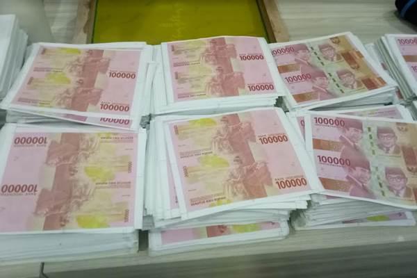 Uang palsu pecahan Rp100.000 edisi baru. - Bisnis/Juli Etha